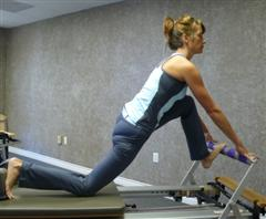 hip flexor stretch on reformer image