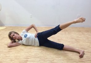 pilates side kicks on exercise mat  image