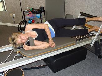 side lying exercise on pilates reformer imag