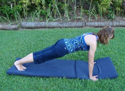 how to engage the core in plank image
