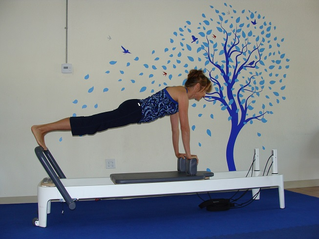 Pilates reformer workout image