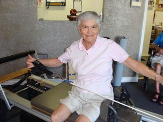 older woman doing pilates image