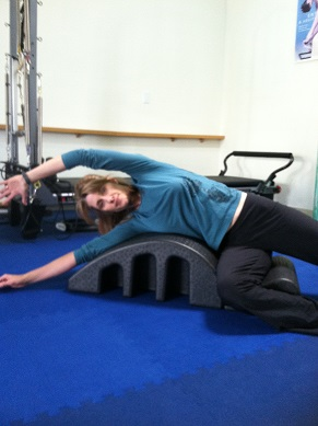 Pilates side stretch on arc image