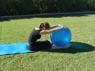 pilates spine stretch forward over exercise ball image