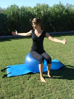 pilates spine twist on exercise ball