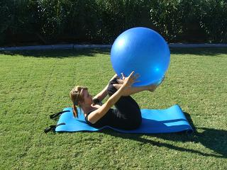 rolling with exercise ball image