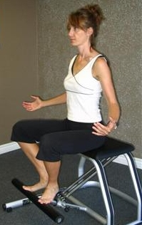 knee strengthening exercise on the pilates chair image