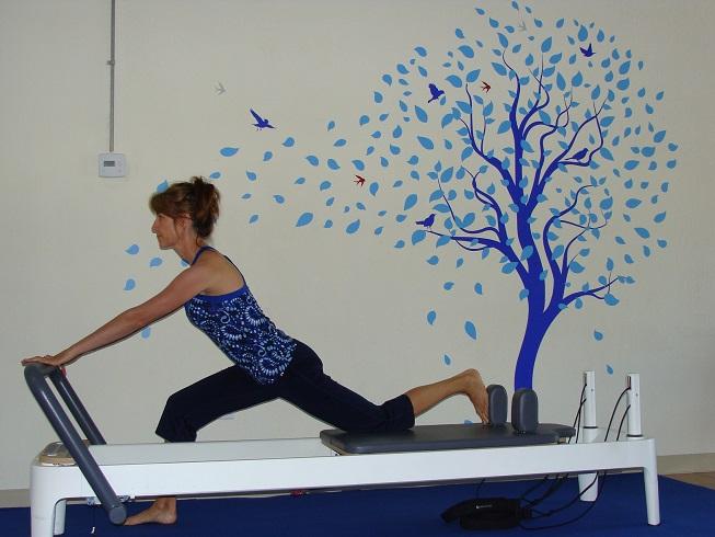 Pilates reformer exercise lunge image
