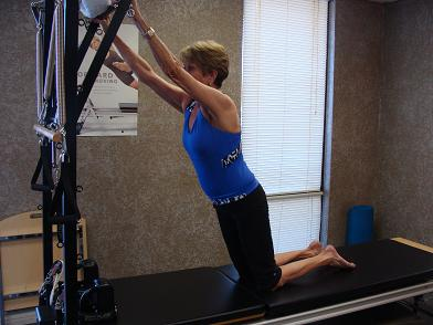 pilates cadillac exercise image