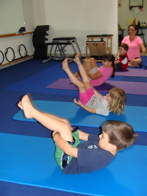 kids rolling Pilates