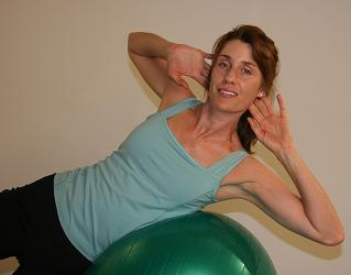 pilates ball side oblique exercise image