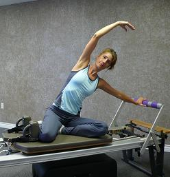 pilates side bending exercise image